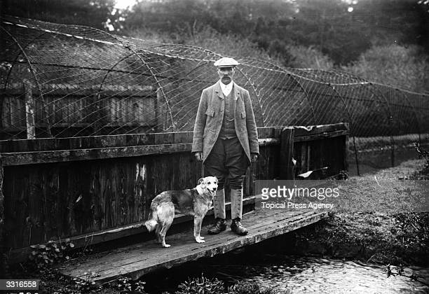 Mr Morley, the Duke of Leeds' head gamekeeper, with his dog.