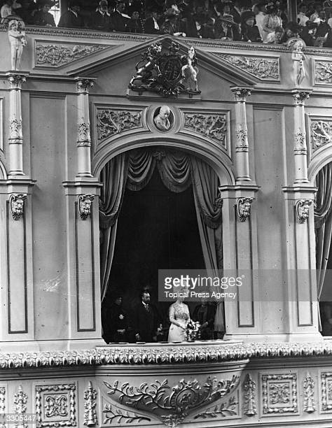 King George V king of Great Britain with his queenconsort Queen Mary in the Royal Box at Crystal Palace London for the Festival of Empire