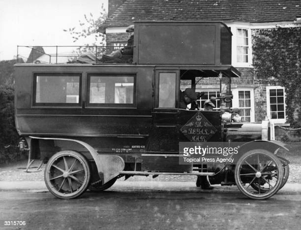 A passenger motor mail van at Ashford in Kent