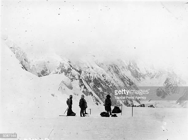 Members of the Bullock Workman expedition in the Himalayas discover the north source of the Siachen glacier