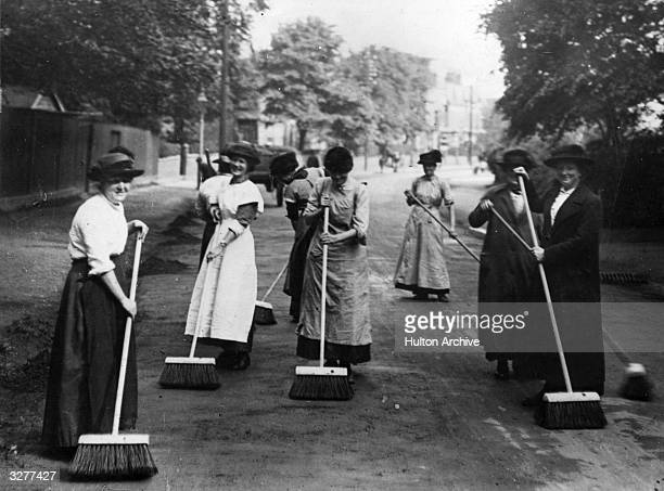 Women road sweepers taken on during the First World War