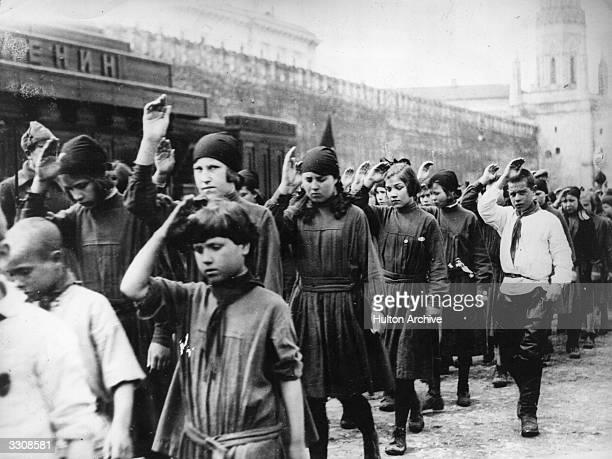 Young Communists saluting as they pass Lenins Tomb on May Day