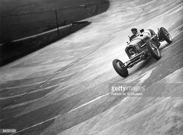 Powys Lybbe racing his Alfa Romeo at Brooklands Surrey during preparations for the International Trophy 250 mile race