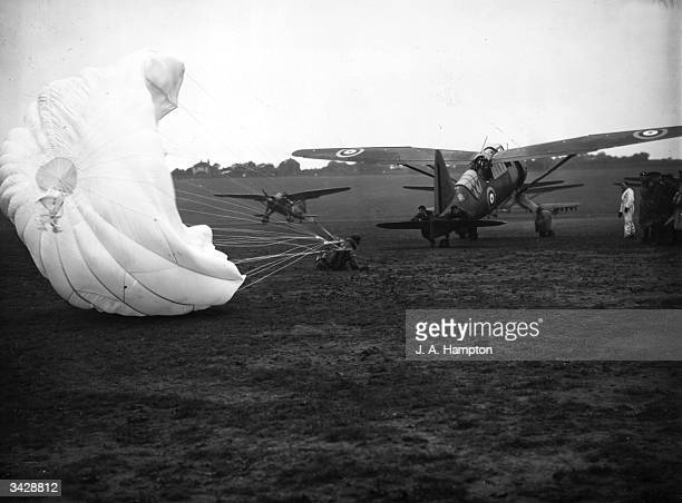 At RAF Hawkinge Kent a pilot undergoes parachute opening experience in the slipstream of a stationary plane