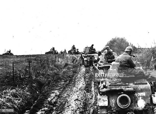 Several Renault R35 light tanks of the French army exercising somewhere in France The tanks are decorated with loving hearts
