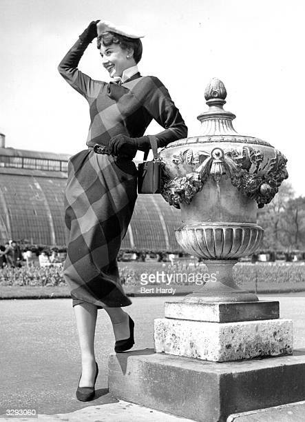 Belgian born actress Audrey Hepburn leaning on an ornate urn in Kew Gardens Original Publication Picture Post 5035 We Take A Girl To Look For Spring...