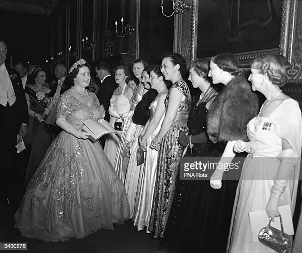 Queen Elizabeth Queen Consort to King George VI meeting the guests at a reception in aid of the Royal School of Needlework at St James' Palace London