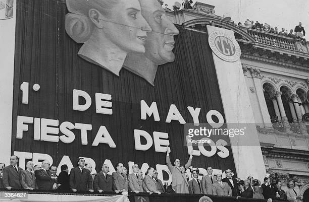 Argentine president Juan Peron addressing the May Day gathering from the balcony of Government House Buenos Aires Above him are portraits of himself...