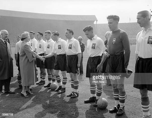 Queen Elizabeth The Queen Mother meeting Preston North End football team before their FA Cup Final match against West Bromwich Albion FC at Wembley...