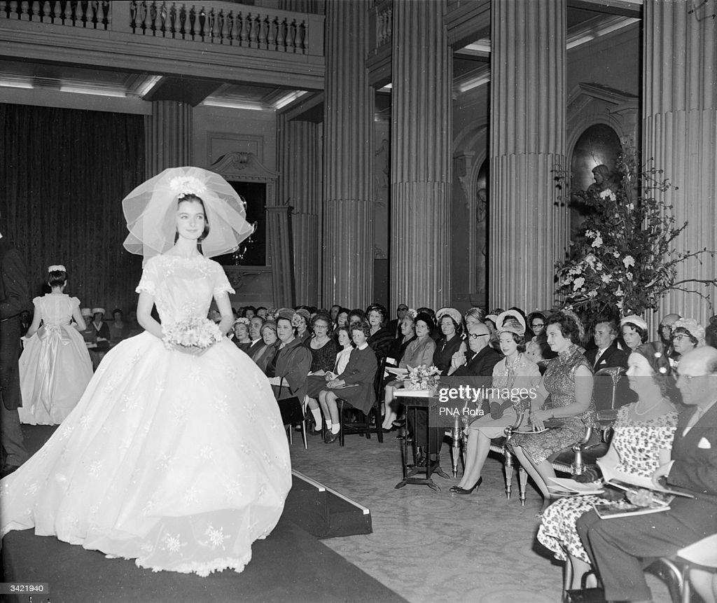 Princess Margaret Watching A Model Wearing A Crinoline Wedding