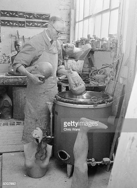 Wax caster, Alec Williams melting down an unsuccessful head of Labour politician, George Brown at Gem's Ltd, in the Portobello Road area of west...
