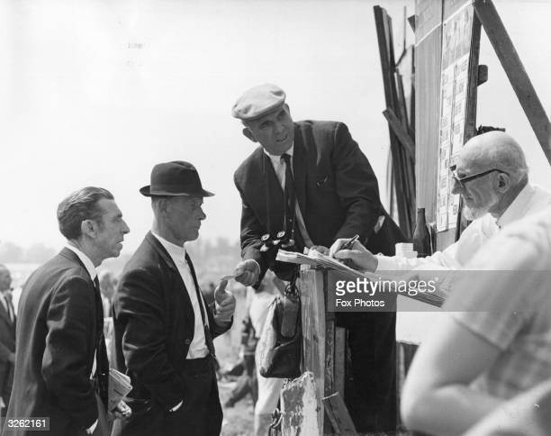 A bookmaker taking bets at the Derby meeting at Espom racecourse