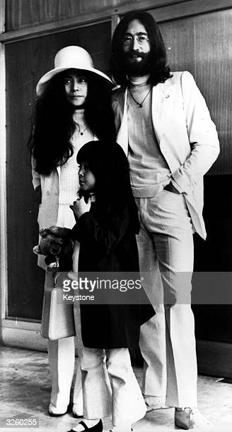 John Lennon former member of The Beatles with his wife Yoko Ono and her daughter Kyoko at London Airport where they are leaving for the Bahamas