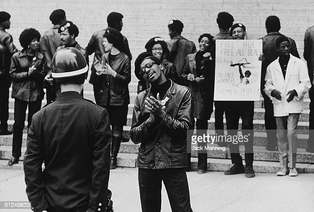 1st May 1969, Members of the Black Panthers applaud during a demonstration outside of the Criminal Courts building New York City. They were...