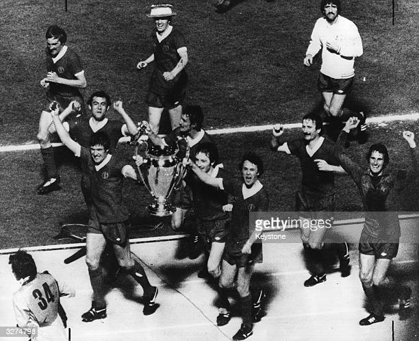The triumphat players of Liverpool FC carry the trophy on a lap of honour after beating Kerussia Moenchangladbach 31 in the European Cup final in the...