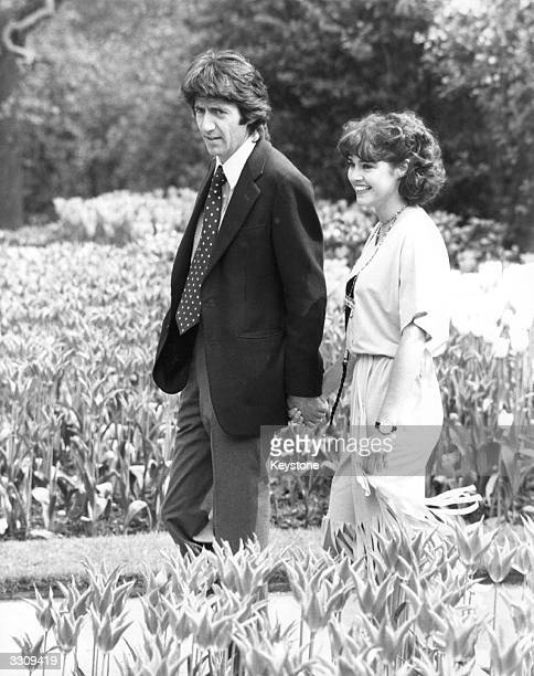 Gemma Craven and Tom Conti walking in Temple Gardens London to publicise the musical 'They're Playing Our Song'