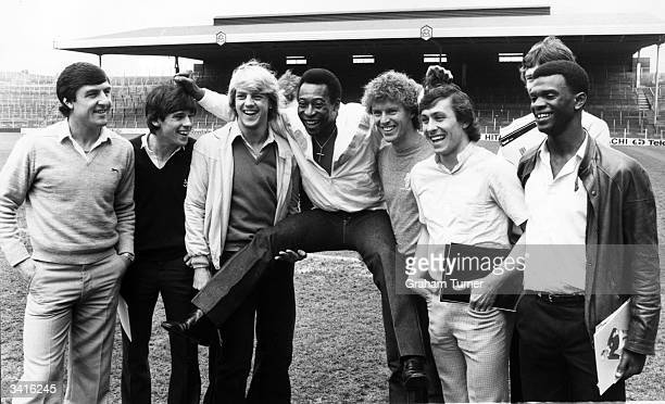 Brazilian football player Pele meets members of the Arsenal football team at Highbury Arsenal have just joined a sponsorship venture with Ingersoll...