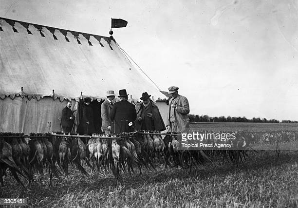 King Edward VII who ascended the British throne in 1901 inspects the bag at a shoot at Sherbourne near Sandringham Norfolk