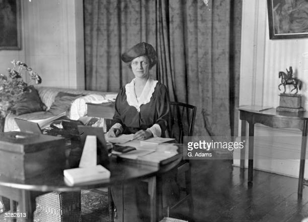 American-born British politician Nancy Witcher Langhorne, Viscountess Astor , Conservative candidate at the Plymouth election sitting at a worktable....