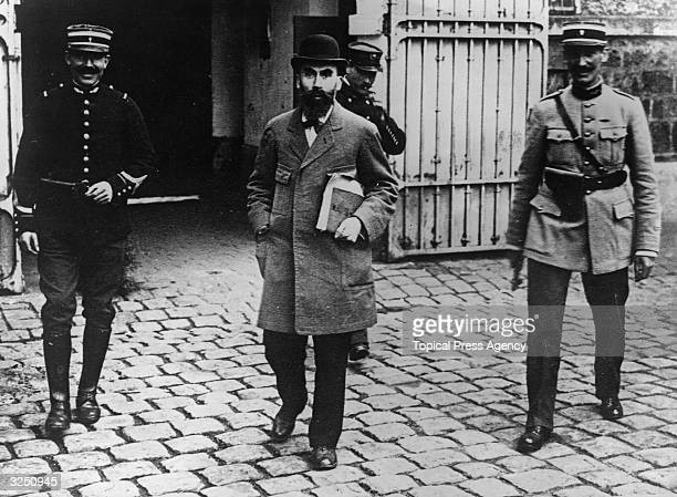 Murderer Henri Desire Landru under triple guard on his way to the courts Known as the French 'Bluebeard' Landru was found guilty of the murder of ten...