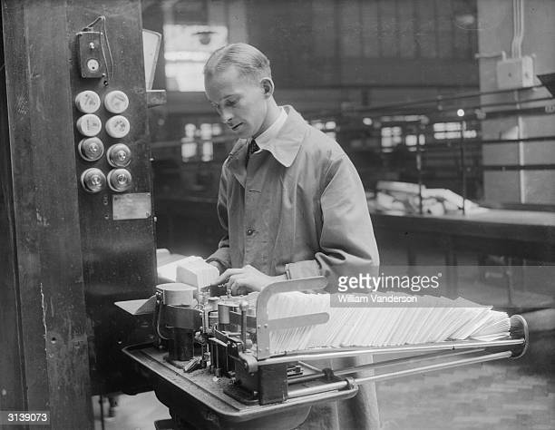 Worker sorting mail at the Mount Pleasant post office, London, using the new mechanical apparatus.