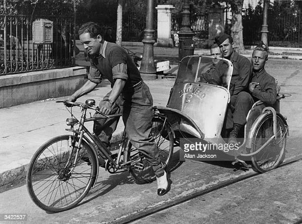 Three US soldiers go for a joyride through the streets of Nice on a bicycletaxi after the Liberation This is the most popular form of transport in...