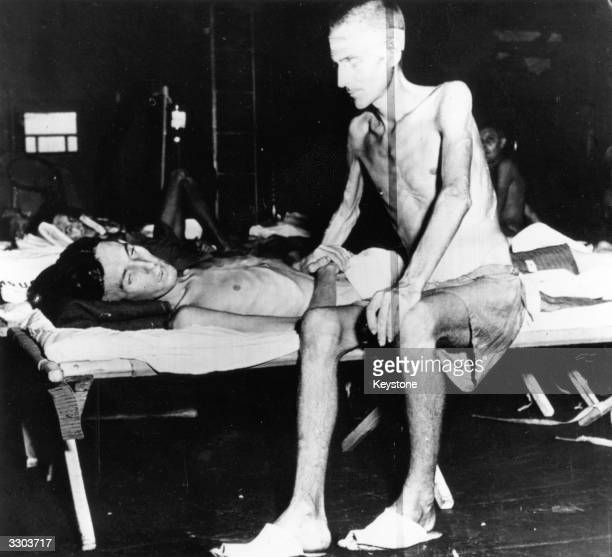 Two emaciated soldiers liberated from the Japanese prison camp on Formosa recovering from their ordeal on board the USS 'Block Island'