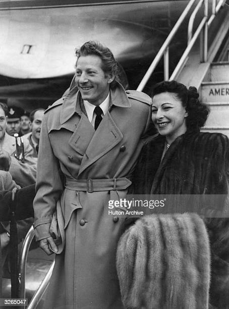 American actor and comedian Danny Kaye arrives at London Airport with his wife Sylvia Fine