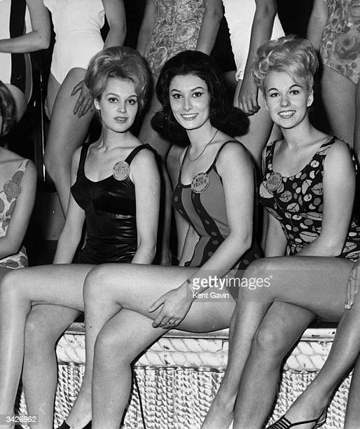 From left to right Miss Finland, Miss France and Miss Germany attend a rehearsal for next year's Miss World Pageant at the Lyceum Theatre, London.