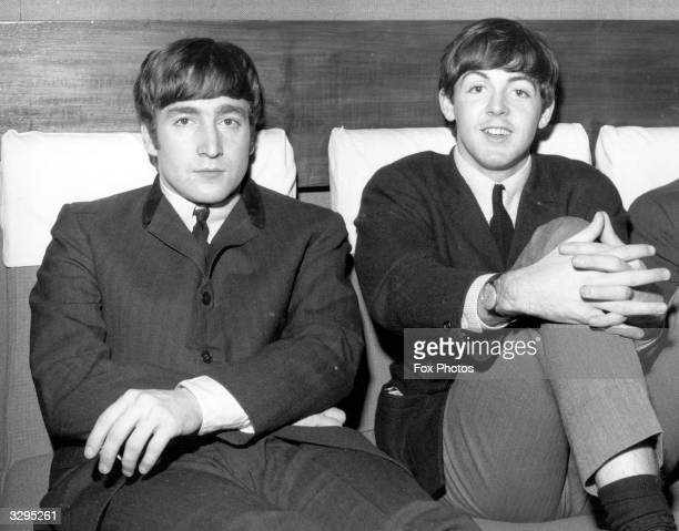 Two members of Liverpudlian pop group The Beatles John Lennon singer and guitarist left and Paul McCartney singer and bass guitarist
