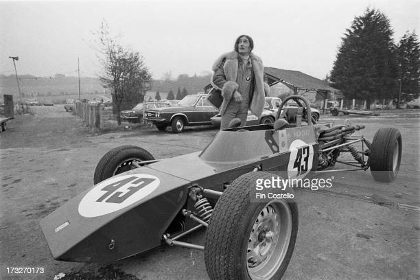 Ken Hensley keyboard player with rock group Uriah Heep posed with his Formula Ford 1600 Dulon car at Brands Hatch racing circuit in Kent England in...