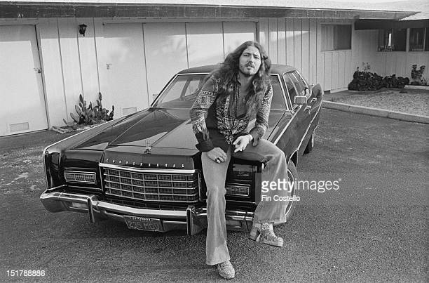 Lead singer David Coverdale from rock group Deep Purple poses on the hood of a Lincoln Continental car in Los Angeles prior to the band's tour of...