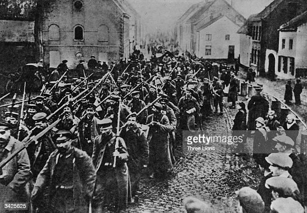 The defeated German army struggling homeward following the Armistice
