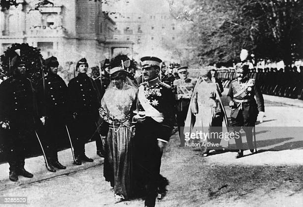 Queen Marie of Romania and King Alexander Karadjordjevic of Yugoslavia at the wedding of Prince Paul of Serbia and Princess Alex of Greece.