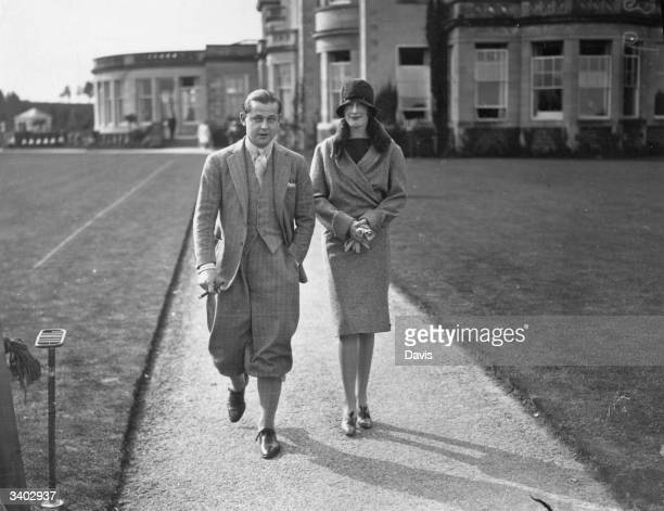 Mr and Mrs Peter Koch de Gooreynd on their honeymoon at Gleneagles Hotel in Scotland; the hotel is in the background. Gleneagles Hotel has four golf...