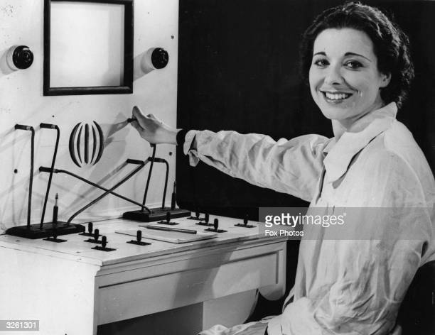 Canadian actress Joan Miller at the switchboard in the television studio at Alexandra Palace preparing for her part in 'Picture Page' The BBC...
