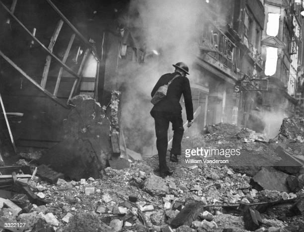 Warden inspecting the damage after German aircraft dropped bombs on the city.