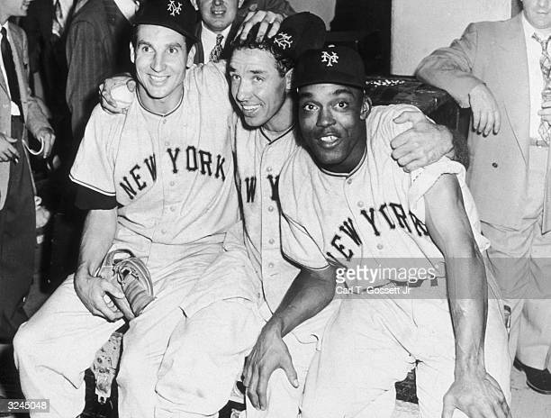 LR New York Giants baseball players Jim Hearn Bobby Thomson and Monte Irvin smile together in the clubhouse after winning a game during the World...