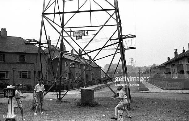 A group of boys play in the shadow of a high voltage electricity pylon in the Scottish industrial town of Kilmarnock Kilmarnock is home to a variety...