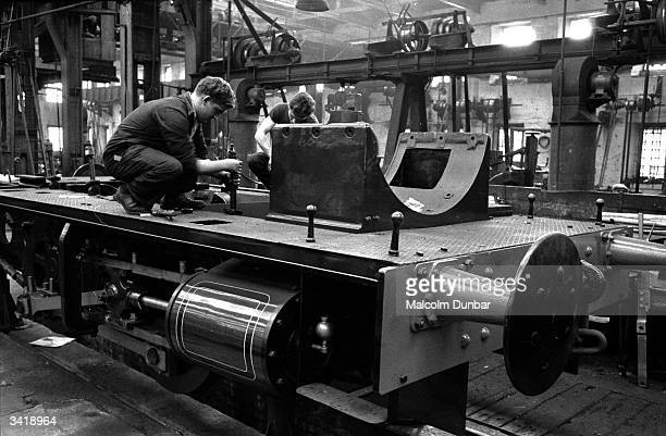 A worker operating a large piece of machinery in a factory in the Scottish industrial town of Kilmarnock Kilmarnock is home to a variety of...