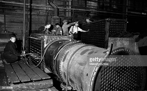 Men working on a large piece of machinery in a factory in the Scottish industrial town of Kilmarnock Kilmarnock is home to a variety of industries...