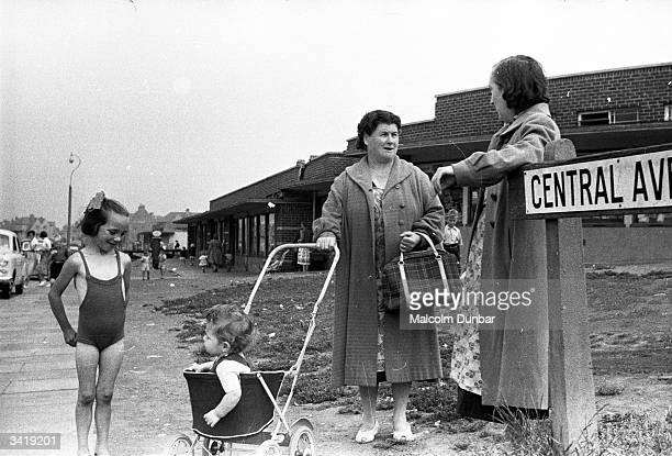 Two women with children in tow chat at the corner of Central Avenue in the Scottish industrial town of Kilmarnock Kilmarnock is home to a variety of...