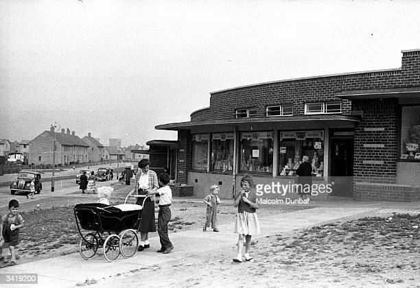 Women and children on a street in the Scottish industrial town of Kilmarnock Kilmarnock is home to a variety of industries including the Johnnie...