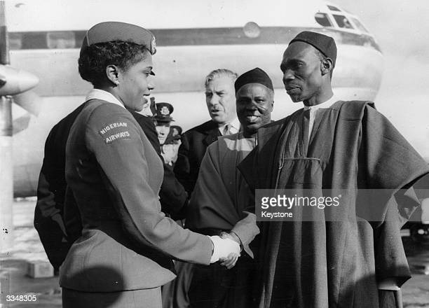 The first Nigerian prime minister Abubakar Tafawa Balewa greets air stewardess Miss Christina Twsela after the inaugural flight of the WAAC