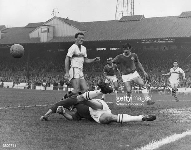 Chelsea goalkeeper Reg Matthews clears the ball during an Everton attack Chelsea's Terry Venables moves in to cover his goalkeeper as Everton's J...