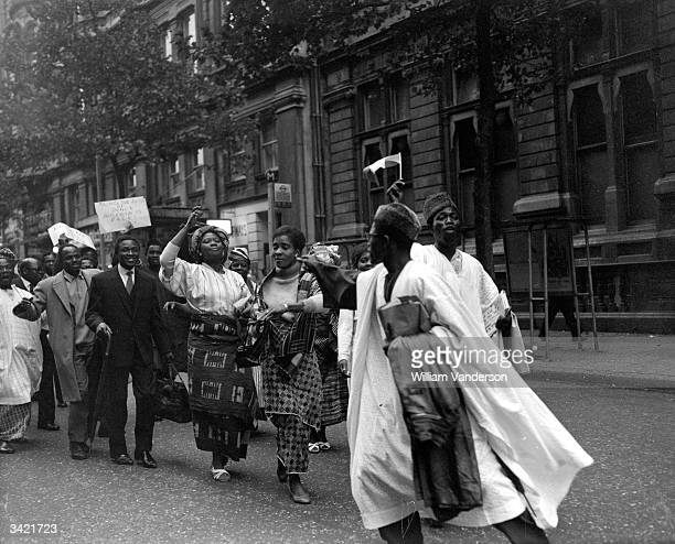 Nigerian students celebrating independence outside Nigeria House in London.