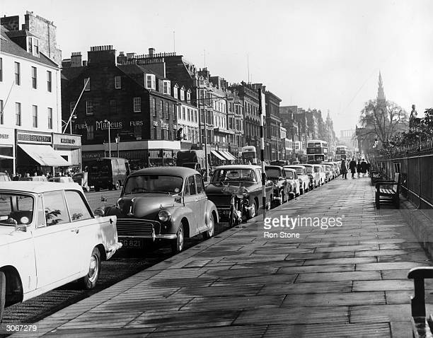 Princes Street Edinburgh with cars parked at the kerbside Named after George III's sons the street was designed by James Craig who built hotels and...