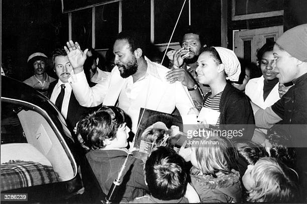 American soul singer Marvin Gaye visits the Mangrove Cafe in All Saint's Road London and is mobbed by admirers on the way out to his car