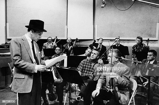 1st OCTOBER: American singer Frank Sinatra in a Los Angeles studio recording 'The Man with the Golden Arm' soundtrack with Elmer Bernstein and Shorty...