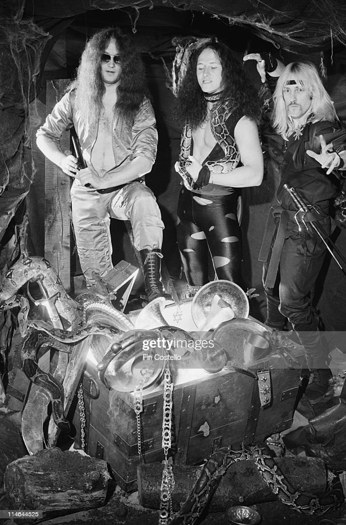 Heavy Metal band Venom posed with snakes and a treasure chest in London in October 1985. Left to right: drummer Anthony 'Abaddon' Bray, bassist Conrad 'Cronos' Lant and guitarist Jeffrey 'Mantas' Dunn.